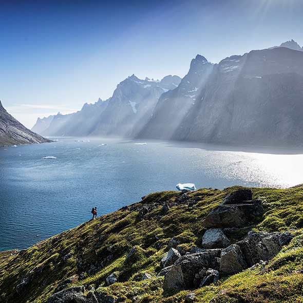 Hiking up the mountain with beautiful views of fjords and mountains