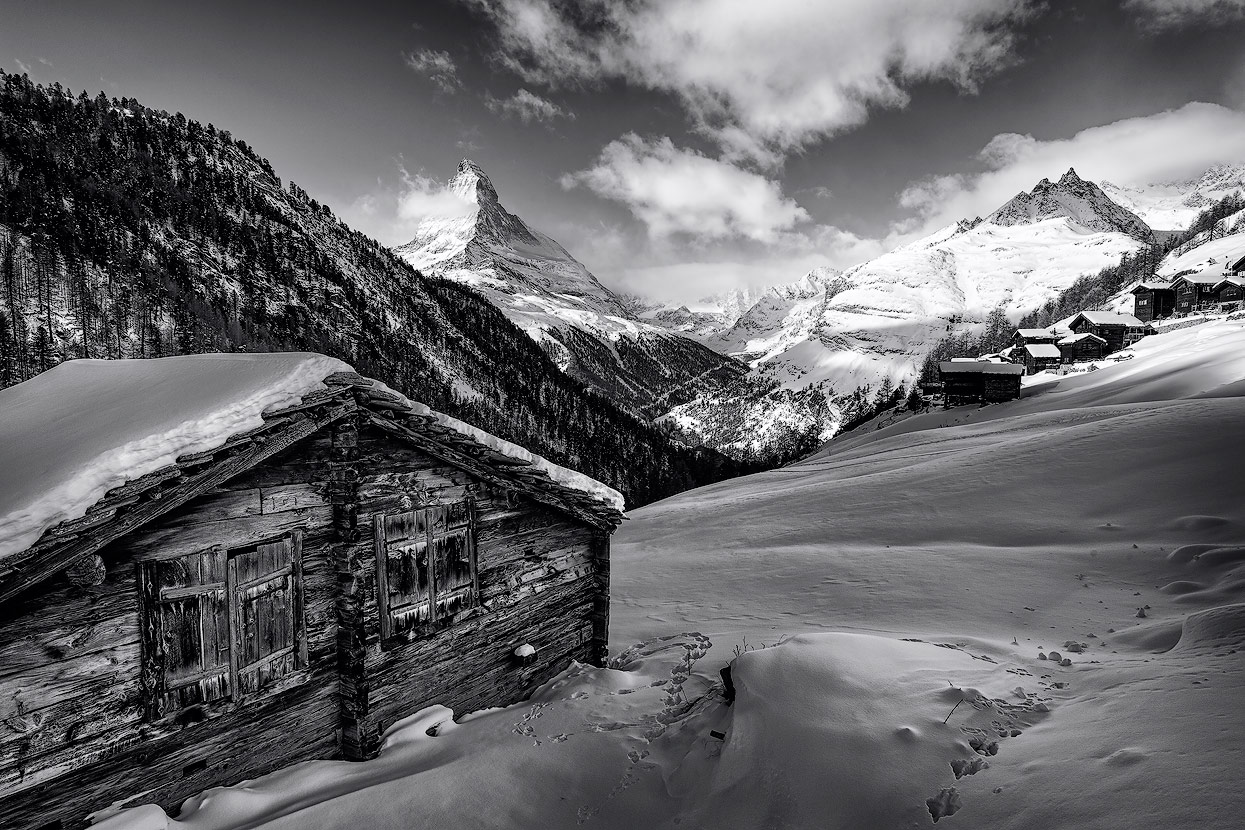 Those wooden huts are a perfect foreground especially when they're covered with snow