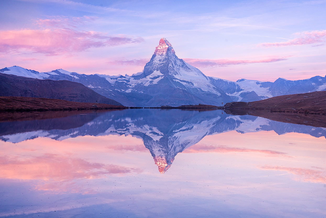 Perfect reflection of mount Matterhon (Mont Cervin) on Stellisee. Early morning shot.