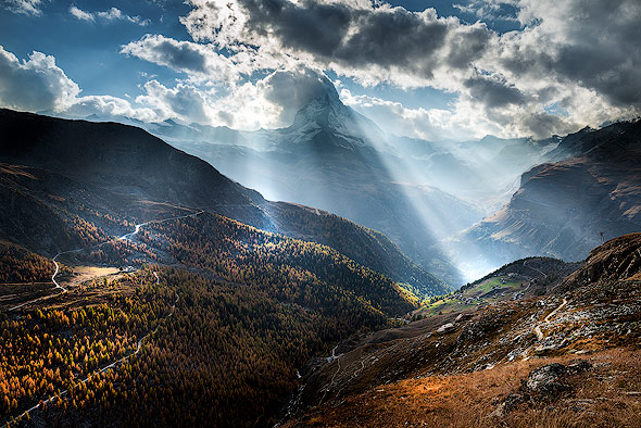Beautiful sun rays behind Mount Matterhorn