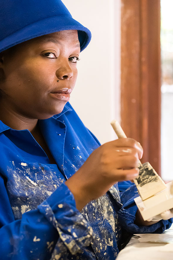 Woman working at T-Bag Factory, Imizamo Yethu