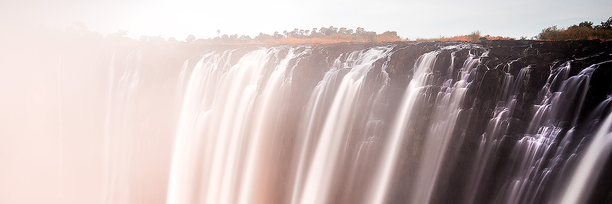 Long exposure sunset shot of Victoria Falls from the Zambian side